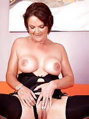 Mature brunette Foxy shows off her amazing big boobies and pussy