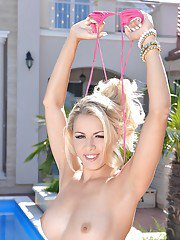 Milf blonde Christen poses naked at the poolside and masturbates