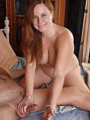 Mature Jessica is licking tasty white juice from her palm in close-up