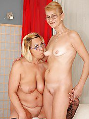 Lesbians in glasses Milli and Beata A are taking off their clothes