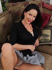 Beauty milf DeSire Delgoto takes off her skirt pretty slowly!
