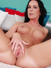Mature brunette Alicia shows her amazing round boobies and tattoos