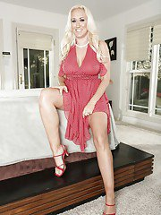 Spicy long-haired milf Alana Evans demonstrates her amazing tits