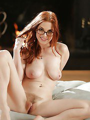 Babe in glasses Penny Pax is posing naked and masturbating hard