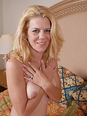 Horny as hell mature blonde Lori takes off her sexy black panties