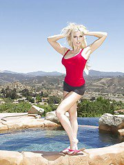 Beautiful blonde Jeannie Marie Sullivan takes off her clothes