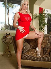 Milf blonde Holly Heart takes off her red dress and spreading legs