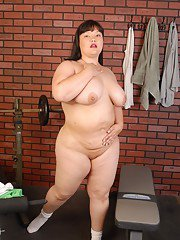 Fatty Asian mature Olivia slowly takes off her tight clothes