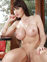Sensual long-haired milf Janice Griffith demonstrates her lingerie