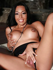 Black-haired mature Rio Lee is demonstrating her stunning boobies