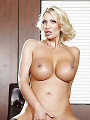 Hot mom Leigh Darby is posing in the office like a pornstar!