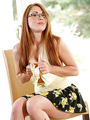 Redhead tattooed babe in glasses Scarlett Wild gets naked!