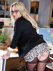 Babe blonde Olivia Austin poses in the office like a pornstar