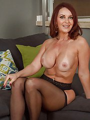 Janet Mason a mature pantyhouse undressing to show her piercing