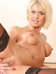 Mature babe Cathie wears her favorite outfit for hot solo scene