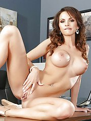 Curly office babe Ashley Sinclair gets on table and wiggles her buns