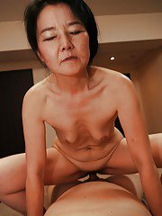 Bushy Asian milf named Takako Numai rides medium Japanese penis