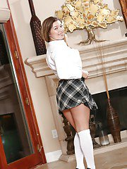 Babe in white socks and high-heels Audrey Bell poses over fireplace