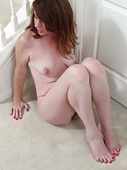 Frisky mature woman Joanie Bishop bares her lonely wet pussy