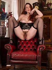 Older babe Mistique is showing her big tits on high heels and lingerie