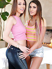 Teen lesbians August Ames and Jade Nile get flirty with each other