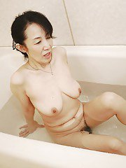 Tsuyako Miyataka getting all wet while taking a much needed bath
