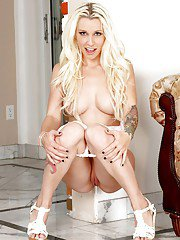 Curvy empress Stevie Shae undressing sensually showing off her goods