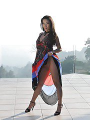 Asian Milf babe Kalina Ryu posing outdoors fully clothed in high heels