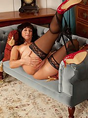 Mature woman Lelani Tizzie baring pussy in black stockings and panties