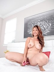Asian milf Lucy Page adores drilling her trimmed pussy with a toy