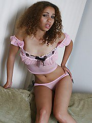 Curly haired ebony vixen Donna E. exhibits her fantastic young body