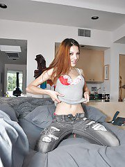 Clothed young sweetie Evilyn posing and stripping denim jeans off