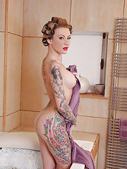 Pierced chick Becky Holt baring her big tattooed boobs after shower
