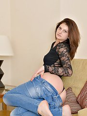 Older dame Eva Johnson posing solo in ass hugging denim jeans