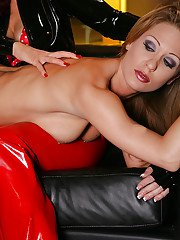 Blonde slut in latex shorts takes toy insertion in hot lezdom action