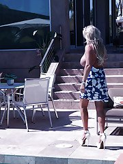 Large breasted housewife Sandra Otterson flashing outdoors in skirt