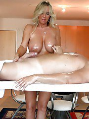 Large chested housewife Sandra Otterson bares breasts to give massage