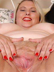 Mature blonde BBW Tawni licks a sex toy for use on her fat vagina