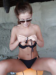 Playing on the sand teen amateur Whitney shows off her firm boobs