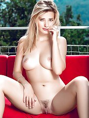 Blonde centerfold model Anna Tatu baring her trimmed cooter outdoors