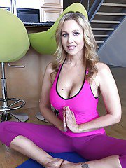 Beautiful MILF Julia Ann shows off her boobs while doing some yoga