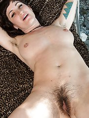 Hairy older woman Stacey Stax shows off her naked hirsute body outside