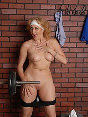 Sports oriented older gal Dana spreads shaved pussy after workout