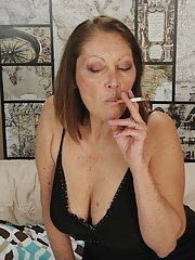 Big breasted mature woman Jane McWilliams smoking a cigarette