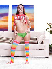 Cute Latina babe in knee high socks flashes her big natural tits