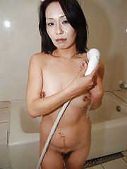 Mature Asian housewife Shimako Kanai showering her hairy pussy
