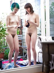 Hairy amateur lesbians Billie T and Bobbie helping each other get dressed