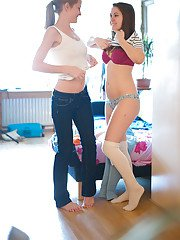 Naughty lesbian amateurs Blanca and Sicilia putting on panties together