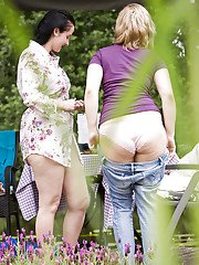 Two fat girls being spied on while getting dressed in the woods