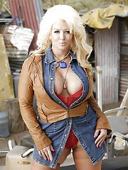 Buxom mature blonde Alura Jackson letting huge hooters loose outdoors